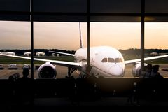 Parked aircraft on tokyo airport through the gate window at Japan Stock Photo