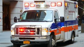 Parked Ambulance flashing lights in Manahttan. New York City, Usa - Apr 2018: Parked Ambulance flashing lights in Manahttan stock footage
