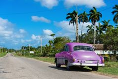 Parked american green Chevrolet classic car at the side street on the Highway to Havana Cuba - Serie Cuba Reportage.  Royalty Free Stock Images