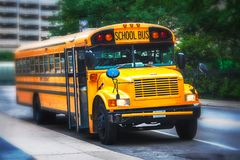 Parked american schoolbus. Front viiew of a schoolbus parked in the streets. Selective focus royalty free stock image