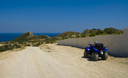 Parked ATV. On the island of Rhodes, Greece. ATVs are one of the best vehicles to rent in order to scout hte less travelled roads royalty free stock image