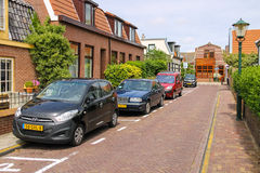 Parked autos on picturesque street in Zandvoort, the Netherlands Royalty Free Stock Photography
