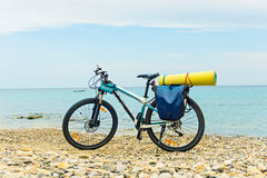 Parked at the beach mountain bike ready to travel. Royalty Free Stock Image