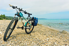 Parked on the beach mountain bike  waiting for the continuation Royalty Free Stock Photography