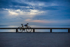 Parked bicycle along a boardwalk railing. Stock Photography