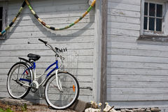Parked bicycle beside boathouse Stock Photography