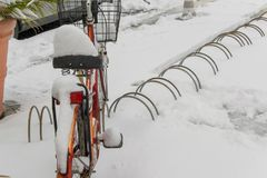 Parked bicycle covered by the snow. Space for text Royalty Free Stock Image
