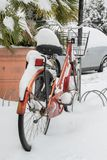 Parked bicycle covered by the snow. Space for text Stock Photo