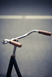 Parked bicycle handlebar Royalty Free Stock Photos