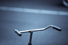 Parked bicycle handlebar Stock Photo