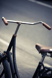 Parked bicycle handlebar Stock Images