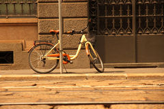 A parked Bicycle in Milan Stock Images