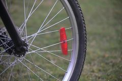 A bicycle`s front tyre with metallic sporks - stock photograph stock photo