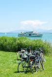 Parked Bicycles and Ferry on an Alpine lake Royalty Free Stock Photo