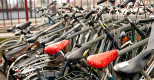 Parked bicycles at the station stock photos