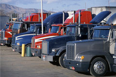 Parked Big Rig Trucks. Big rig trucks in parked at truck stop, Mojave, California Stock Images
