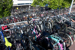 Parked bikes in Amsterdam. Many bikes parked in the centre of Amsterdam, Netherlands Royalty Free Stock Photos