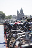 Parked bikes in Amsterdam. Bikes parked on a multi storey bike park with Church in the background Stock Image