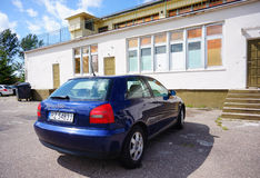 Parked blue Audi. SIANOZETY, POLAND - JULY 26, 2015: Parked blue Audi car in front of a building Stock Photography