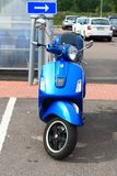 Parked blue scooter in the daytime. Front view stock images