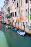 Parked boats on canal in Venice, Italy Royalty Free Stock Photos