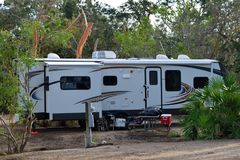 Parked camper trailer. A white camper trailer parked at a campsite in St Augustine, Florida, USA Royalty Free Stock Image