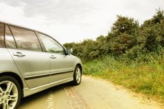 Parked car. A parked car in a dune landscape - yellow filter used on lens Stock Photo