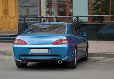 Parked car. Photo of sport car parked near office Royalty Free Stock Photos