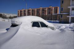 Car completely covered with snow. Parked car in the city completely covered with snow Royalty Free Stock Photo