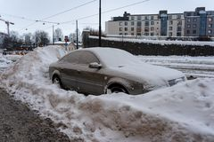 Parked car in the city has been surrounded by big amounts of snow royalty free stock image