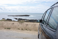 Parked car at coast. A parked car over-looking the Cotes Sauvage coast in France Royalty Free Stock Images