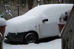 Parked car covered by the snow, space for text. Space for text Royalty Free Stock Photography