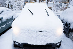 Parked car covered in snow Stock Images