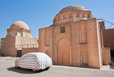 Parked car near the ancient brick building in the Persian style in the historical desert city Royalty Free Stock Photos