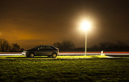 Parked car at night Stock Photos
