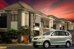 Parked car in residential neighborhood Royalty Free Stock Images