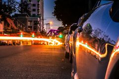 Parked car on road with many lights royalty free stock photo