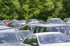 Parked cars. Cars parked on a grass field at a festival Royalty Free Stock Images