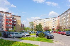 Parked cars apartment blocks Royalty Free Stock Image