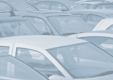 Parked cars background. Telephoto view of cars parked in parking lot toned blue and faded for background use Stock Photography