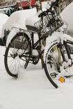 Parked cars and bicycles covered by the snow. Space for text Stock Photography