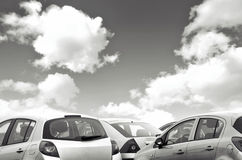 Parked cars black and white Stock Images