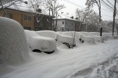 Parked cars blocked by snow. Parked cars blocked by a thick layer of snow stock images