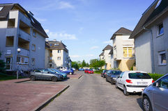 Parked cars homes Stock Photography