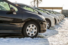 Parked Cars on a Lot. Row of New Cars on the Car Dealer Parking. Lot. Cars for Sale Market Theme Royalty Free Stock Photos