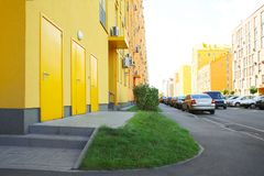 Parked cars near modern buildings. Parked cars near modern colorful buildings Stock Images