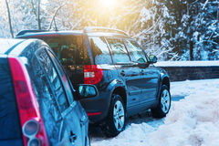 Parked cars at a road in winter Royalty Free Stock Photography