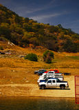 Parked cars on the shore of the lake in the mountains of Califor Royalty Free Stock Photo