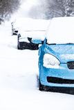Parked Cars on a Snowstorm Winter Day Royalty Free Stock Images