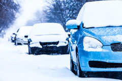 Parked Cars on a Snowstorm Winter Day Royalty Free Stock Photos